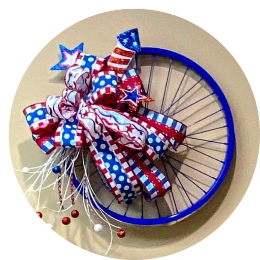 blue bicycle rim with patriotic ribbon and attachments