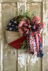 Grapevine Wreath with American flag, large bow and greenery